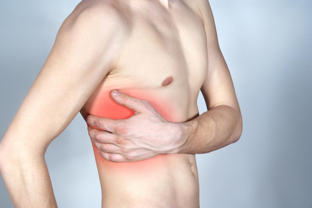 gerinc melletti szúró fájdalom